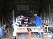 Volunteers working at the workshop